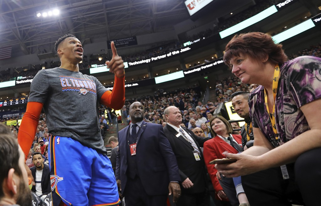 Oklahoma City Thunder's Russell Westbrook gets into a heated verbal altercation with fans in the first half of an NBA basketball game against the Utah