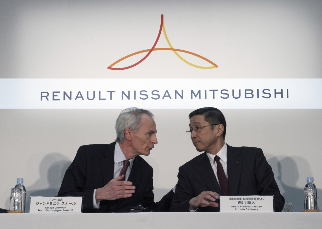 In this March 12, 2019, photo, Renault Chairman Jean-Dominique Senard, left, and Nissan CEO Hiroto Saikawa speak at the start of a joint press confere