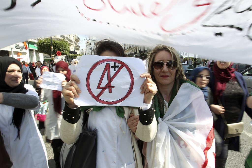 A teacher holds a placard during a protest in Algiers, Algeria, Wednesday, March 13, 2019. Algerian teachers gathered outside the central post office