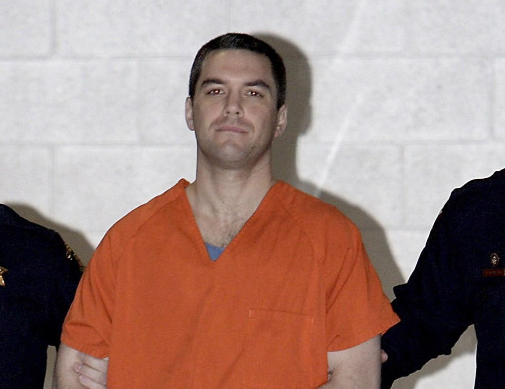 FILE - In this March 17, 2005 file photo Scott Peterson is escorted by two San Mateo County Sheriff deputies to a waiting van in Redwood City, Calif.