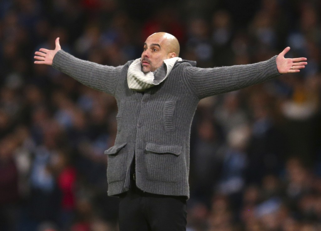 Manchester City coach Pep Guardiola reacts during the Champions League round of 16 second leg, soccer match between Manchester City and Schalke 04 at