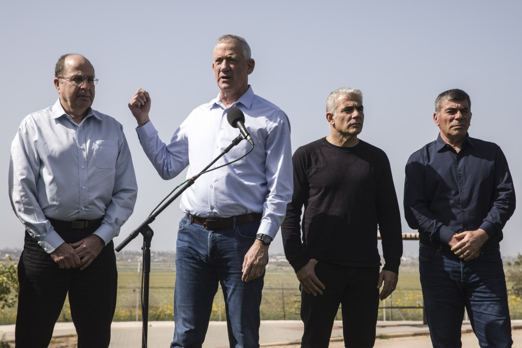 Blue and White party leaders, from the left, Moshe Yaalon, Benny Gantz and Yair Lapid and Gabi Ashkenazi,deliver a statement in Kibbutz Kfar Aza near