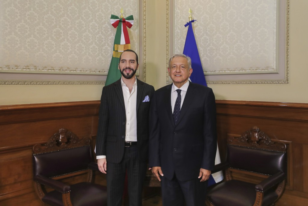 In this photo provided by the Mexican Presidency, EL Salvador's President-elect Nayib Bukele, left, poses for a photo with Mexico's President Andres A