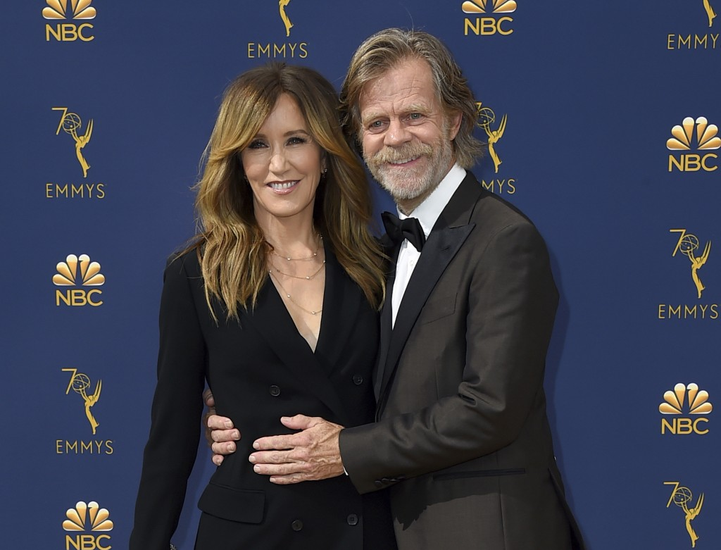 FILE - In this Sept. 17, 2018 file photo, Felicity Huffman, left, and William H. Macy arrive at the 70th Primetime Emmy Awards in Los Angeles.  Huffma...