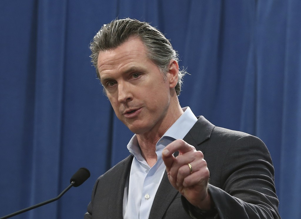FILE - In this Monday Feb. 11, 2019 file photo Calif. Gov. Gavin Newsom answers questions at a Capitol news conference, in Sacramento, Calif. Newsom i