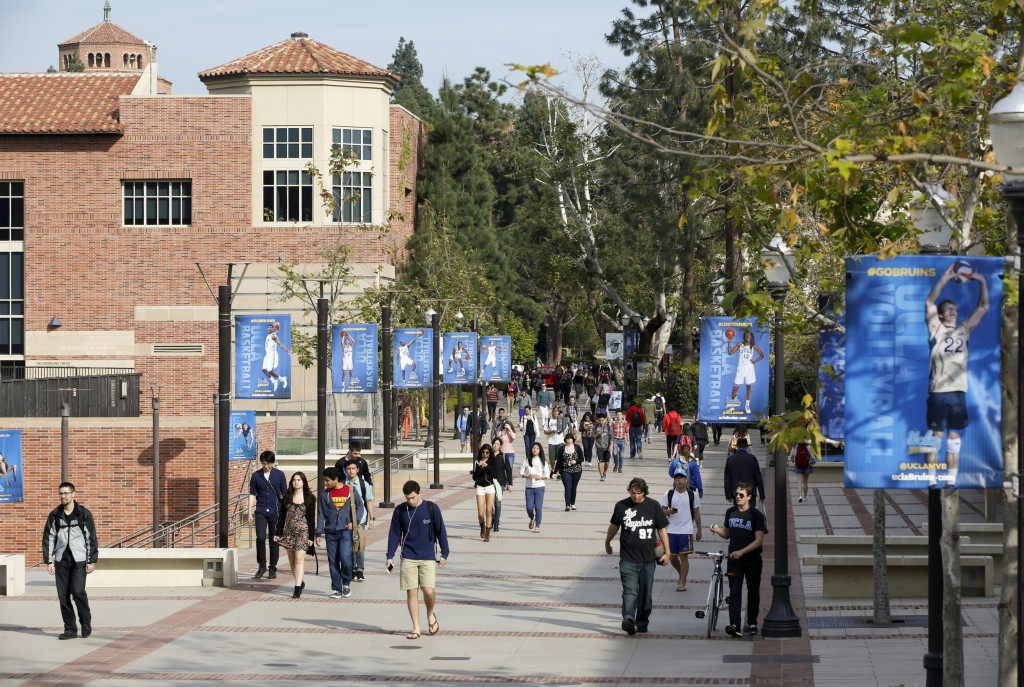 FILE - In this Feb. 26, 2015, file photo, students walk on the University of California, Los Angeles campus. Federal authorities have charged college ...