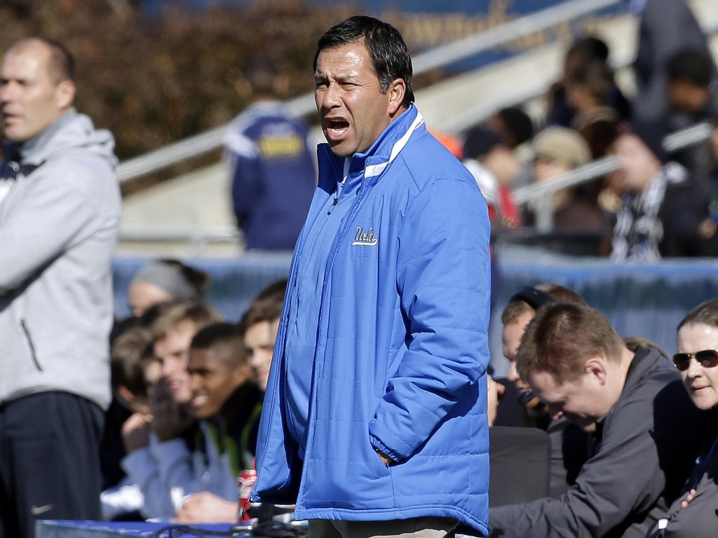 FILE - In this Dec. 14, 2014 file photo, UCLA coach Jorge Salcedo reacts during the first half of an NCAA College Cup championship soccer game against...