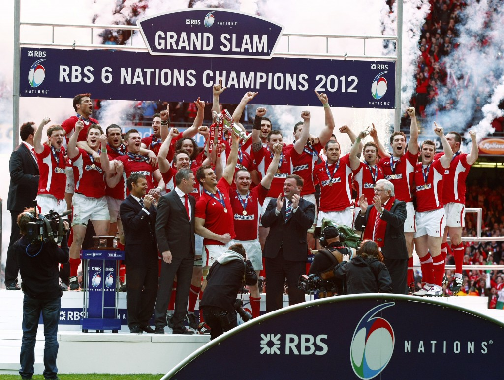 FILE - In this Saturday, March 17, 2012 file photo, Wales' captain Sam Warburton, center, celebrates winning the 6 Nations tournament with teammates a