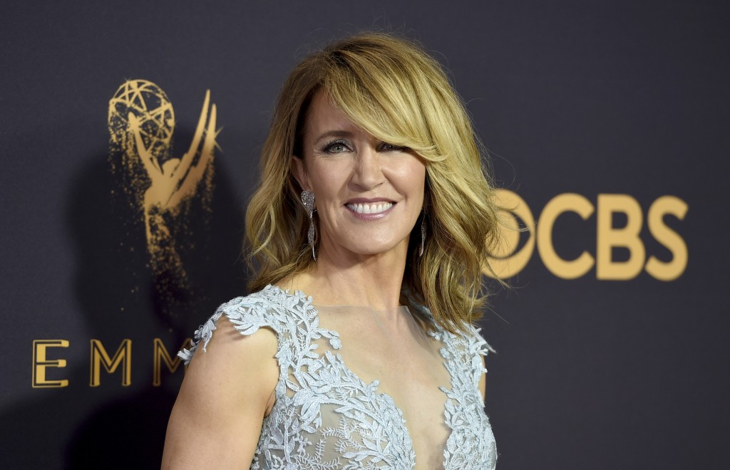 FILE - This Sept. 17, 2017 file photo shows actress Felicity Huffman at the 69th Primetime Emmy Awards in Los Angeles. Huffman and Lori Loughlin have ...