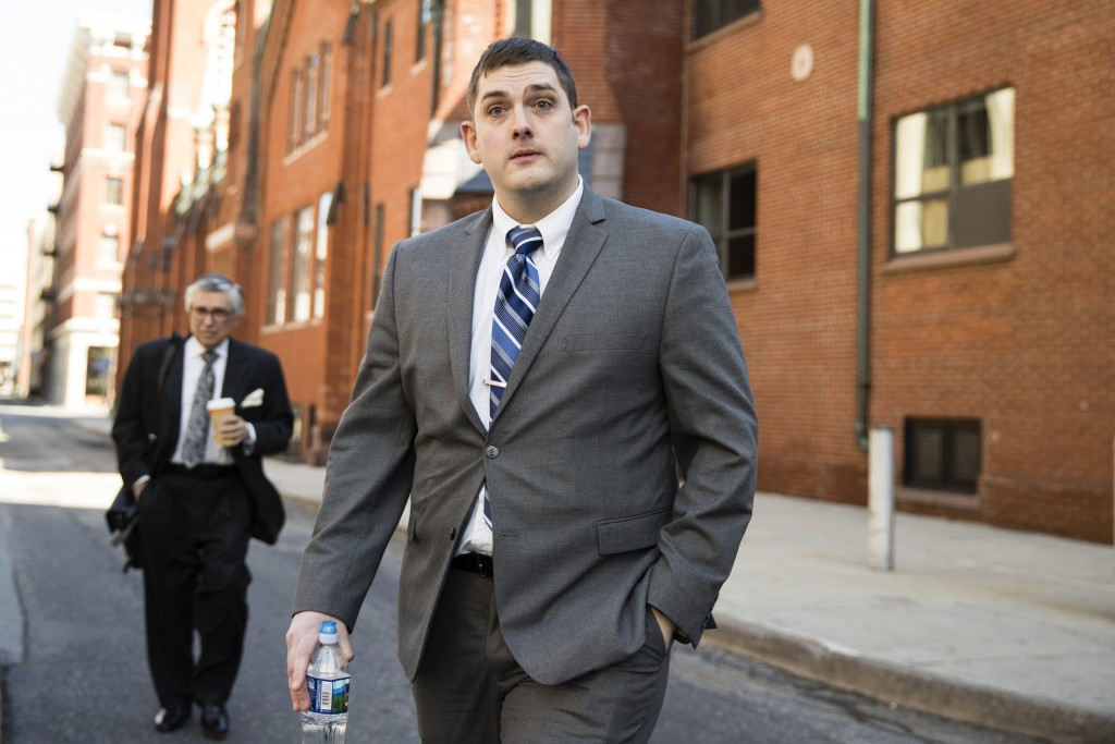Former East Pittsburgh police officer Michael Rosfeld, charged with homicide in the shooting death of Antwon Rose II, walks to the Dauphin County Cour...