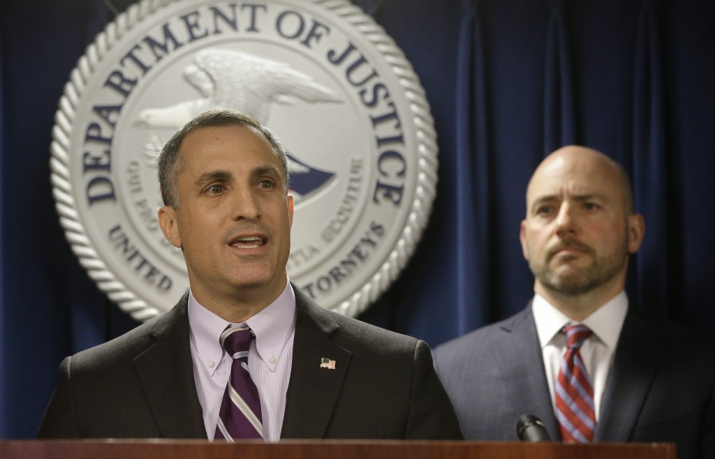 FBI Special Agent in Charge Boston Division Joseph Bonavolonta, left, and U.S. Attorney for District of Massachusetts Andrew Lelling, right, face repo...