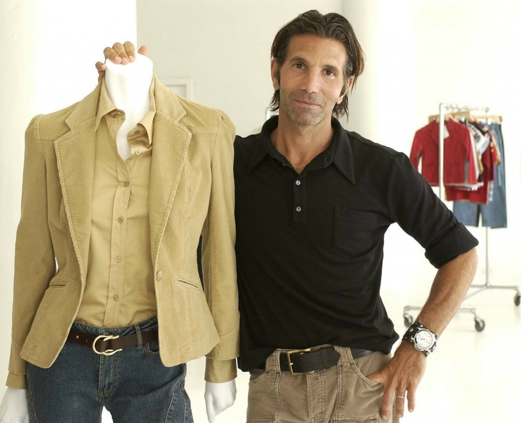 FILE - This May 15, 2002 file photo shows Los-Angeles based clothing designer Mossimo Giannulli posing with his fall preview clothing for Target depar...