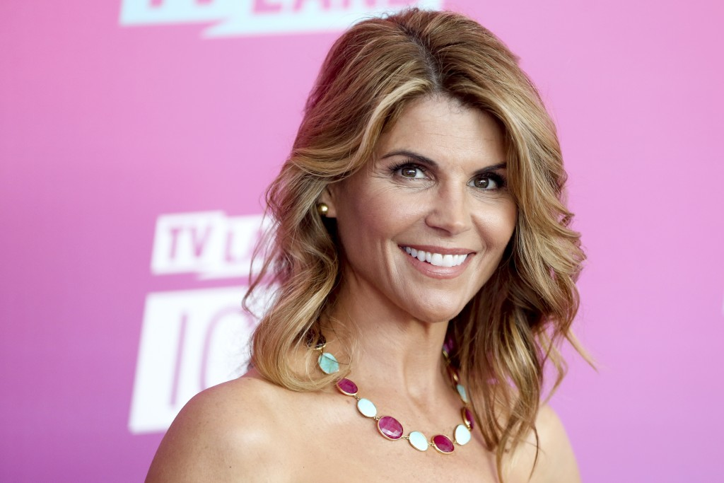 FILE - In this April 10, 2016 file photo, actress Lori Loughlin arrives at the TV Land Icon Awards in Santa Monica, Calif. Felicity Huffman and Loughl...
