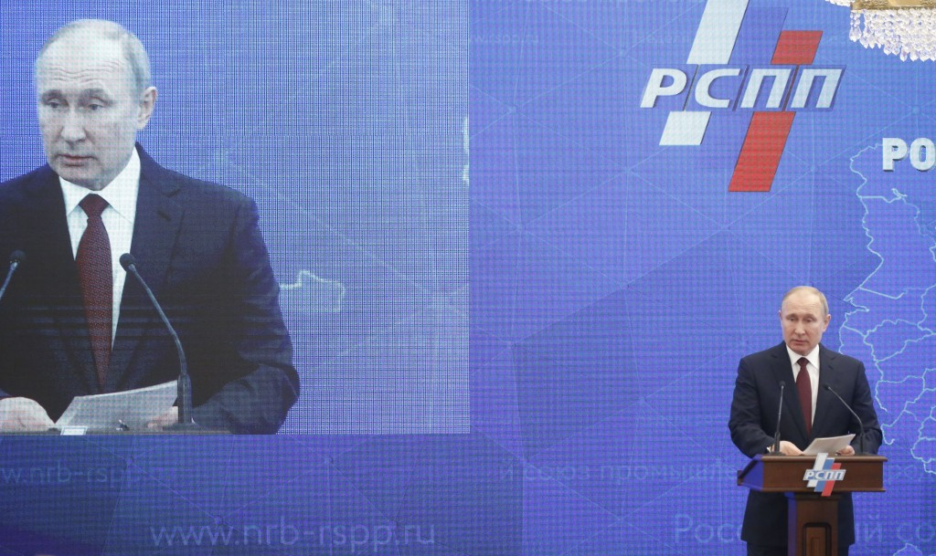 Russian President Vladimir Putin attends a meeting of the Russian Union of Industrialists and Entrepreneurs in Moscow, Russia, Thursday, March 14, 201...