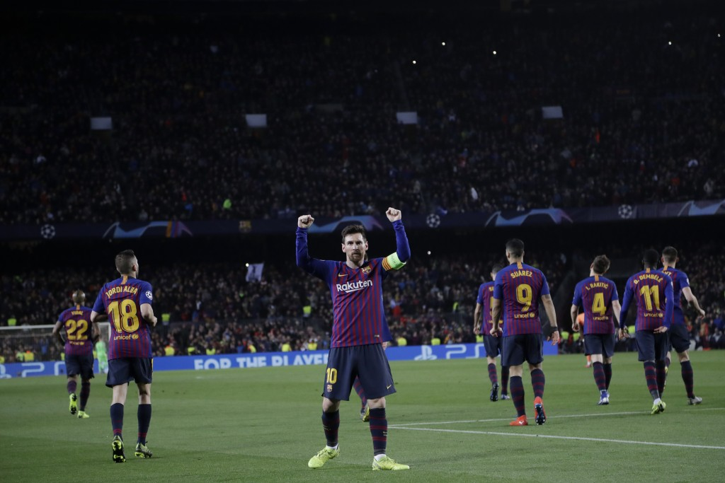 Barcelona's Lionel Messi, centre, celebrates after scoring his side's third goal during the Champions League round of 16, 2nd leg, soccer match betwee