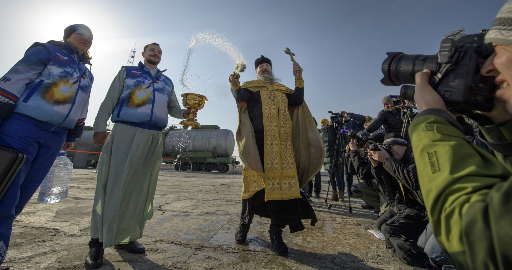 Russian Orthodox Priest Father Sergei blesses members of the media at the Baikonur Cosmodrome launch pad, Thursday, March 14, 2019, in Baikonur, Kazak