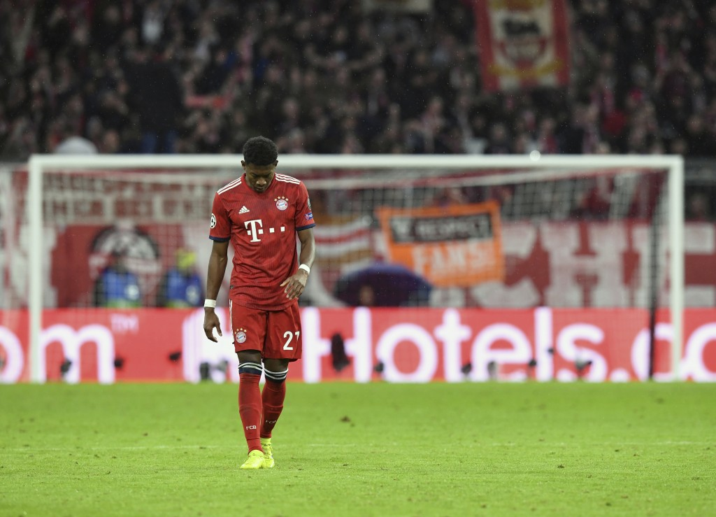 Bayern defender David Alaba reacts during the Champions League round of 16 second leg soccer match between Bayern Munich and Liverpool at the Allianz