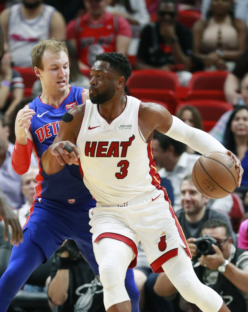 Miami Heat guard Dwyane Wade (3) drives against Detroit Pistons guard Luke Kennard during the first half of an NBA basketball game, Wednesday, March 1