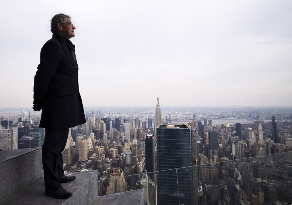 """In this March 8, 2019 photo, Jay Cross, president of Related Hudson Yards, stands on an outdoor observation deck named """"The Edge,"""" 1100 feet (367 mete"""