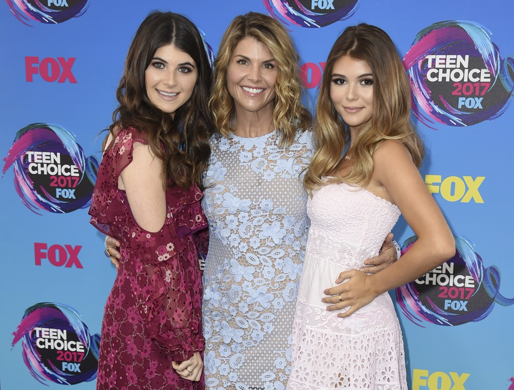 FILE - In this Aug. 13, 2017 file photo, actress Lori Loughlin, center, poses with her daughters Bella, left, and Olivia Jade at the Teen Choice Award