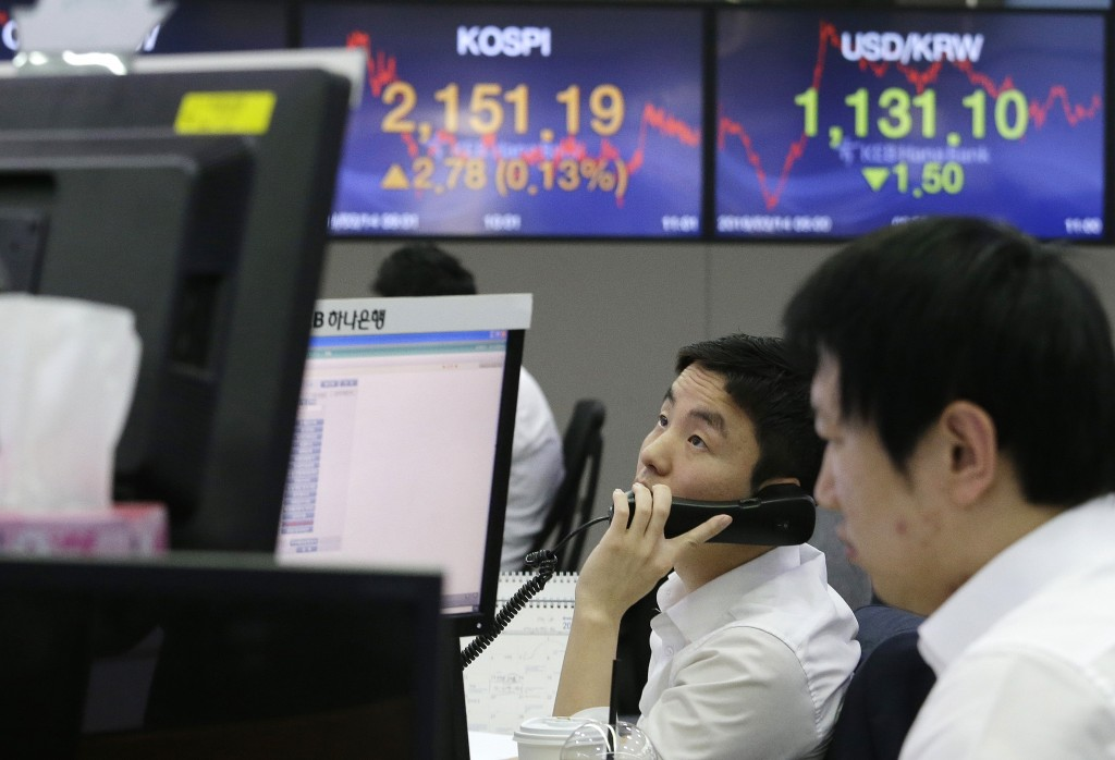 A currency trader talks on phone at the foreign exchange dealing room of the KEB Hana Bank headquarters in Seoul, South Korea, Thursday, March 14, 201...