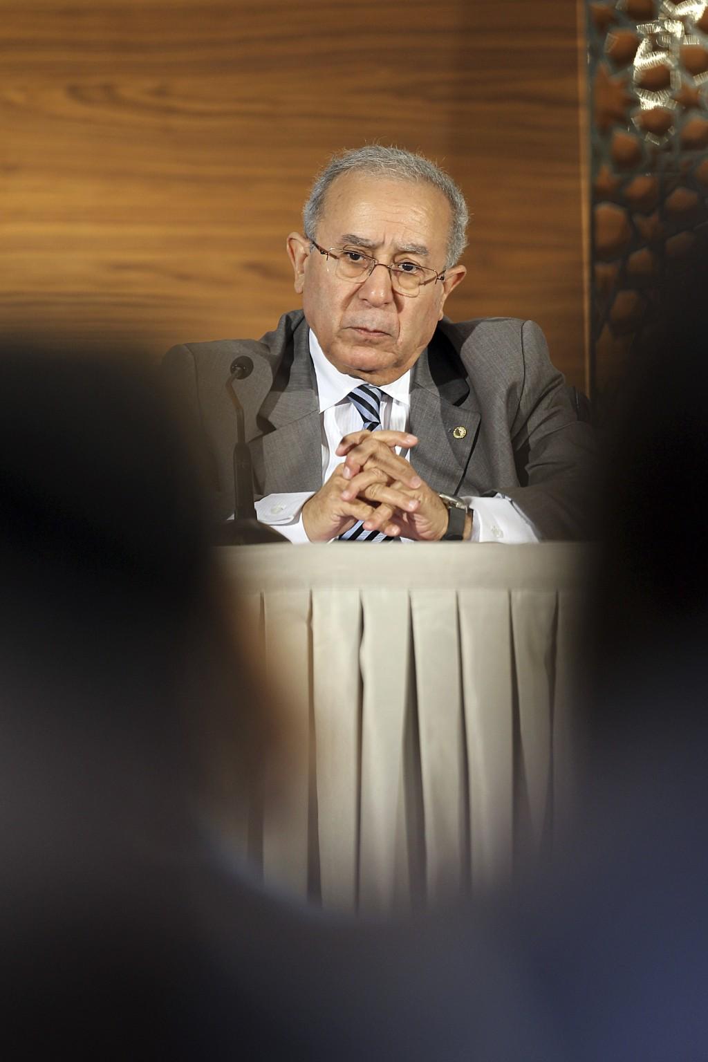 Algeria's Vice Prime Minister Ramtane Lamamra gives a press conference, in Algiers, Algeria, Thursday, March 14, 2019. Algeria's new prime minister is