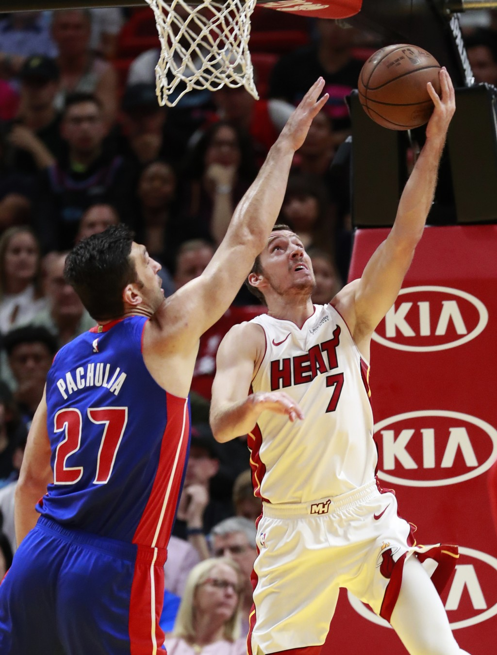 Miami Heat guard Goran Dragic (7) shoots against Detroit Pistons center Zaza Pachulia (27) during the first half of an NBA basketball game, Wednesday,