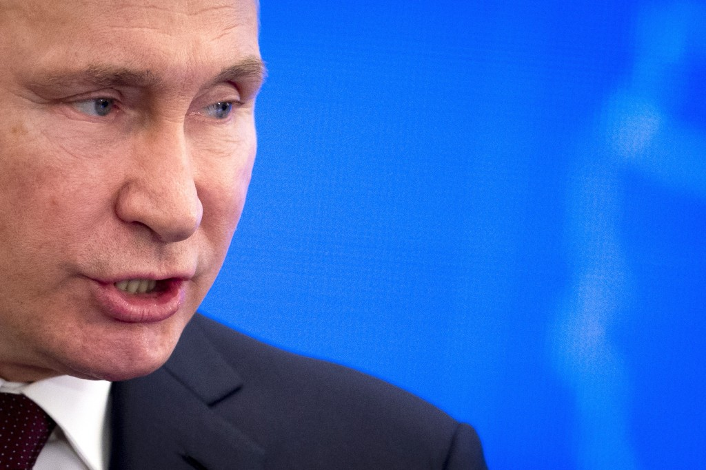 Russian President Vladimir Putin speaks at a meeting of the Russian Union of Industrialists and Entrepreneurs in Moscow, Russia, Thursday, March 14, 2...