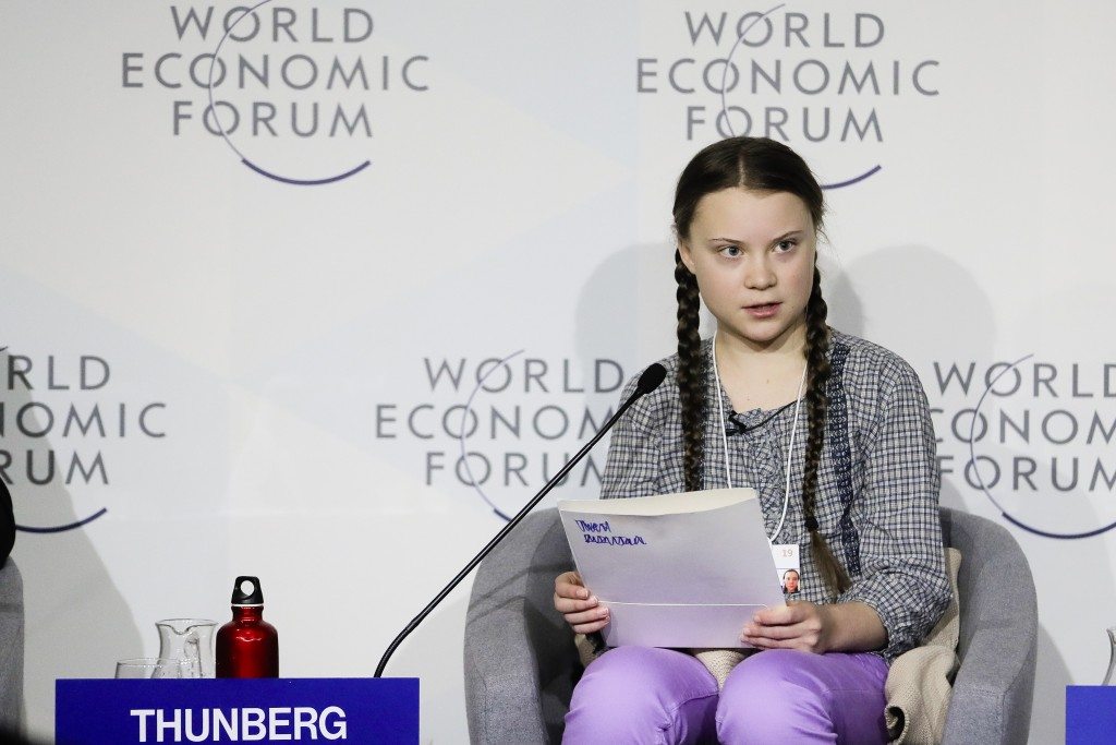 FILE - In this Friday, Jan. 25, 2019 file photo, climate activist Greta Thunberg delivers her speech during a session of the World Economic Forum in D
