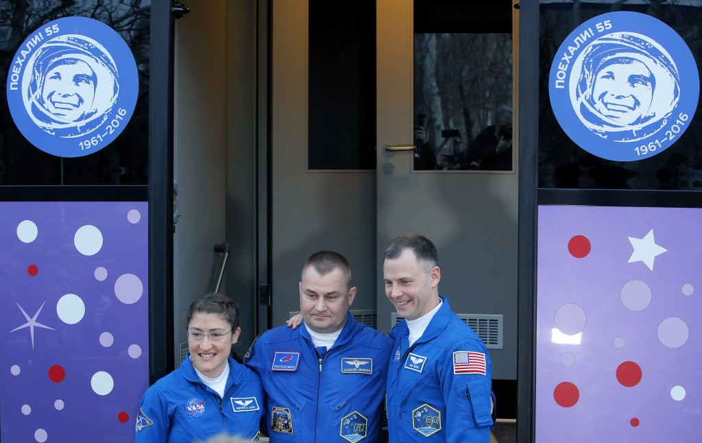 U.S. astronauts Christina Hammock Koch, left, Nick Hague, right, and Russian cosmonaut Alexey Ovchinin, members of the main crew to the International