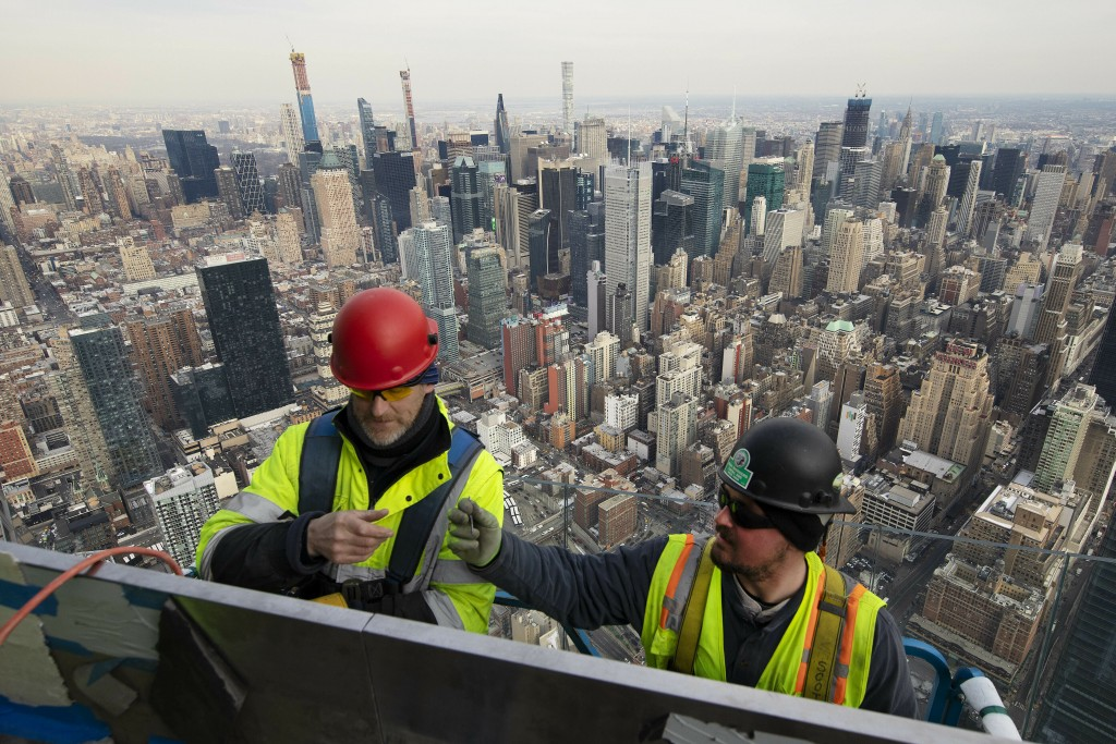 In this March 8, 2019 photo, work continues on an outdoor observation deck on the 30 Hudson Yards office building in New York. It is scheduled to open