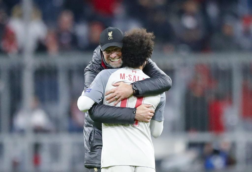 Liverpool coach Juergen Klopp hugs Liverpool forward Mohamed Salah after the Champions League round of 16 second leg soccer match between Bayern Munic