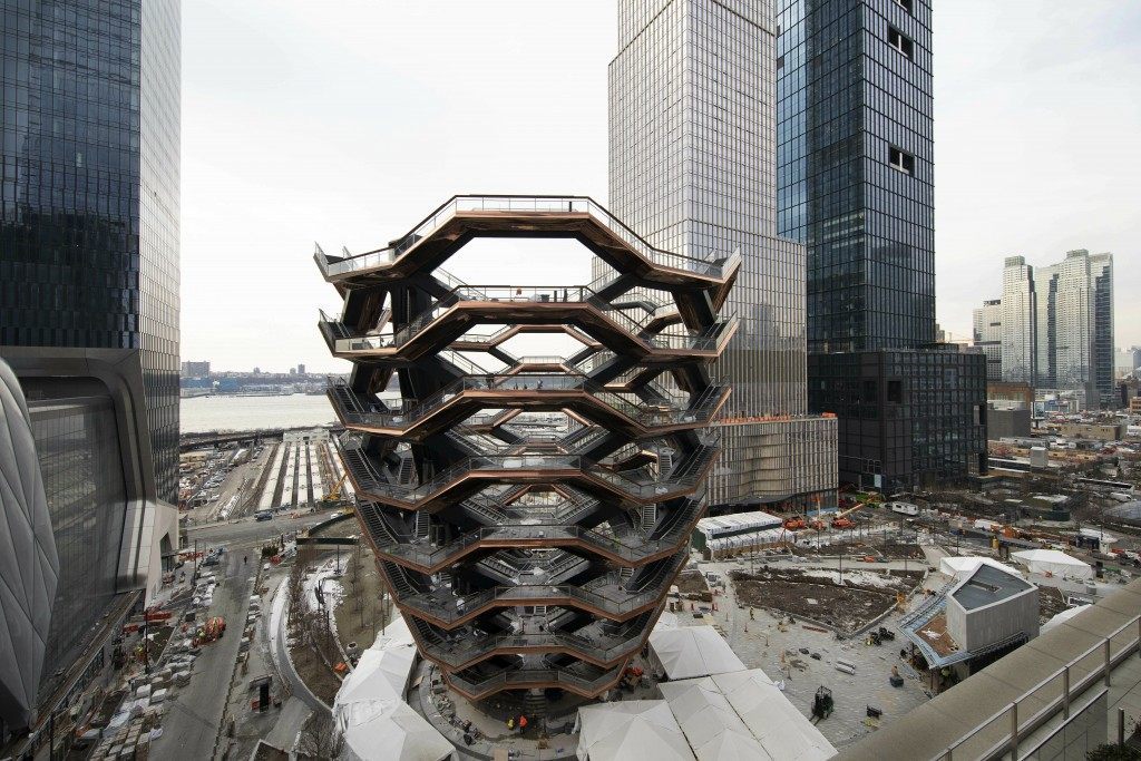 """This March 8, 2019 photo shows the """"Vessel,"""" a 150-foot-tall structure of climbable interlocking staircases in the Hudson Yards development in New Yor..."""