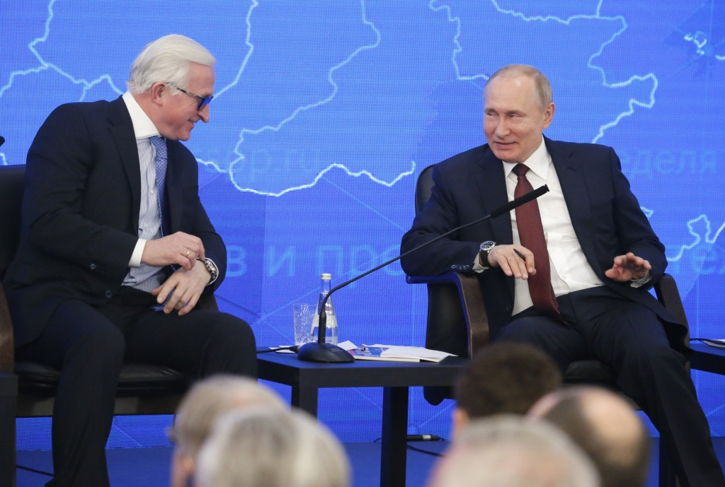 Russian President Vladimir Putin, right, and head of the Russian Union of Industrialists and Entrepreneurs Alexander Shokhin attend a meeting of the R...