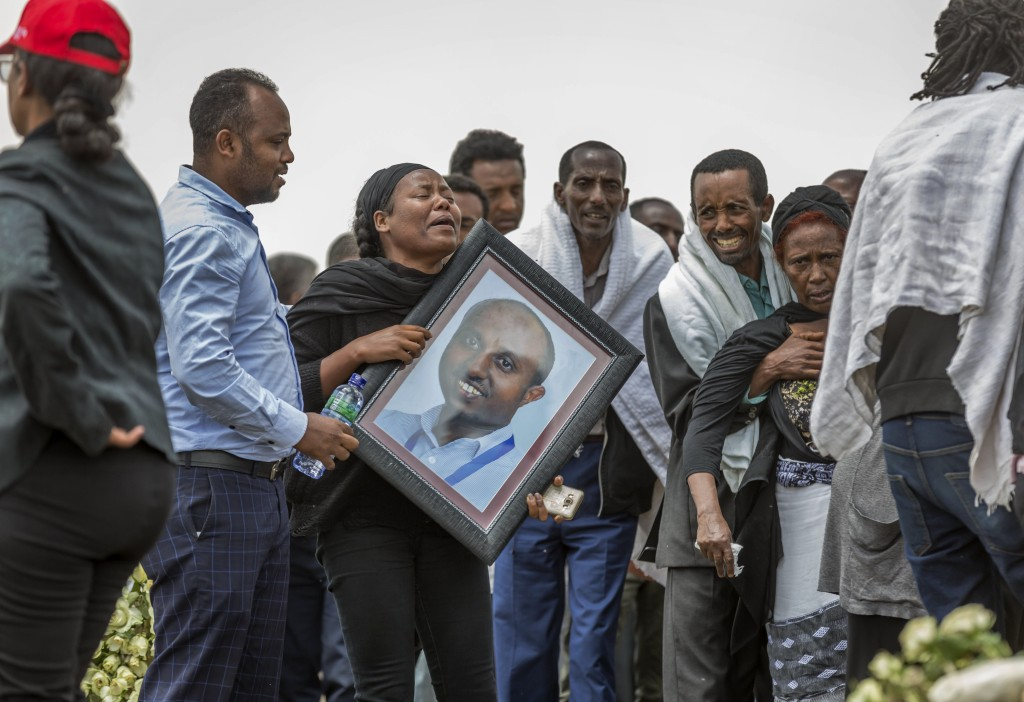 Ethiopian relatives of crash victims mourn and grieve at the scene where the Ethiopian Airlines Boeing 737 Max 8 crashed shortly after takeoff on Sund