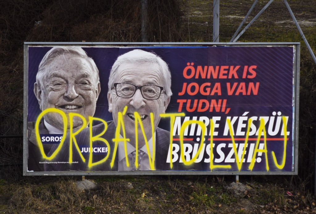 FILE- In this Feb. 26, 2019, file photo, a billboard from a campaign of the Hungarian government showing EU Commission President Jean-Claude Juncker a