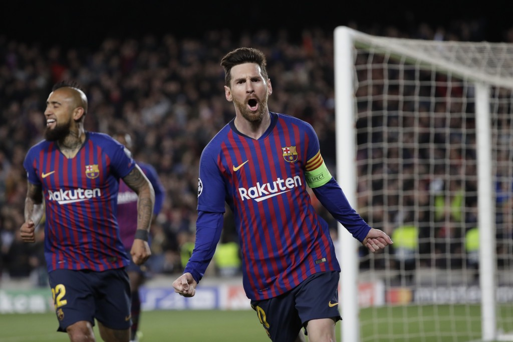 Barcelona's Lionel Messi, right, celebrates after scoring his side's third goal during the Champions League round of 16, 2nd leg, soccer match between