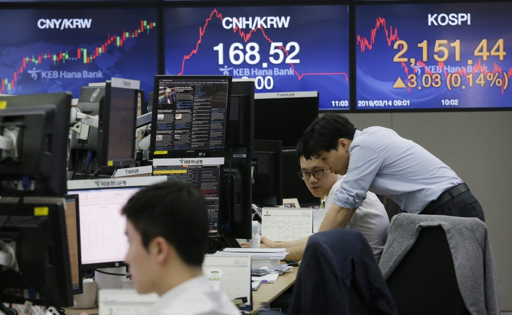 Currency traders watch monitors at the foreign exchange dealing room of the KEB Hana Bank headquarters in Seoul, South Korea, Thursday, March 14, 2019...