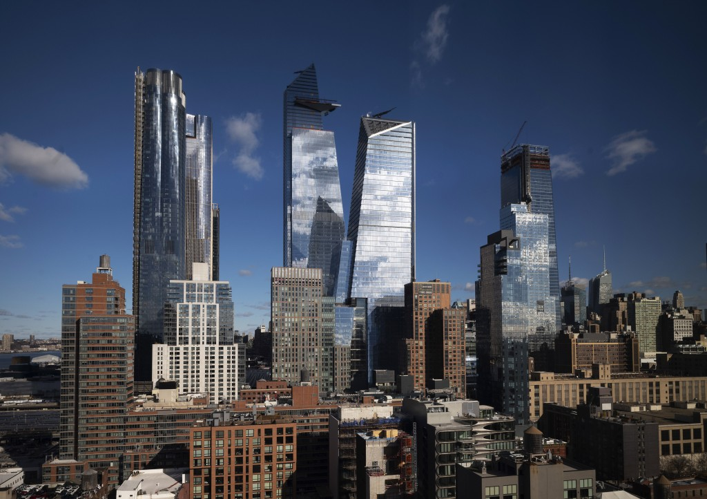 In this Dec. 4, 2018 file photo, new skyscrapers rise above Hudson Yards in the west side of Manhattan in New York. When fully complete, the 28-acre (