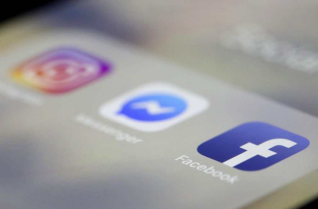 Facebook, Messenger and Instagram apps are are displayed on an iPhone on Wednesday, March 13, 2019, in New York. Facebook says it is aware of outages