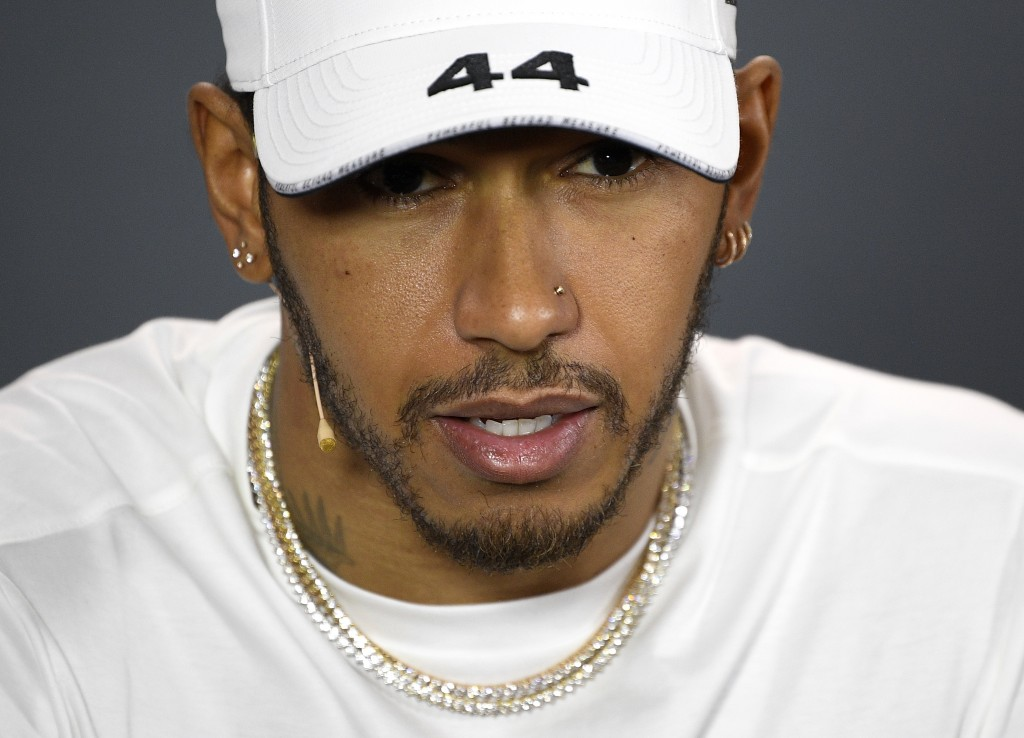 Mercedes driver Lewis Hamilton of Britain answers a question during the drivers press conference ahead of the Australian Formula One Grand Prix in Mel