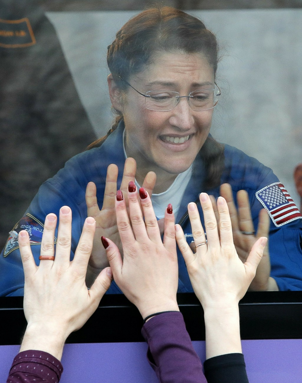 U.S. astronauts Christina Hammock Koch, a member of the main crew to the International Space Station (ISS), interacts with his relatives from a bus pr
