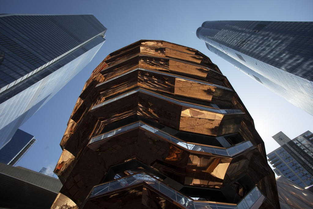 """In this March 5, 2019 photo, the """"Vessel,"""" a 150-foot-tall structure of climbable interlocking staircases, rises above Hudson Yards in New York. The V"""