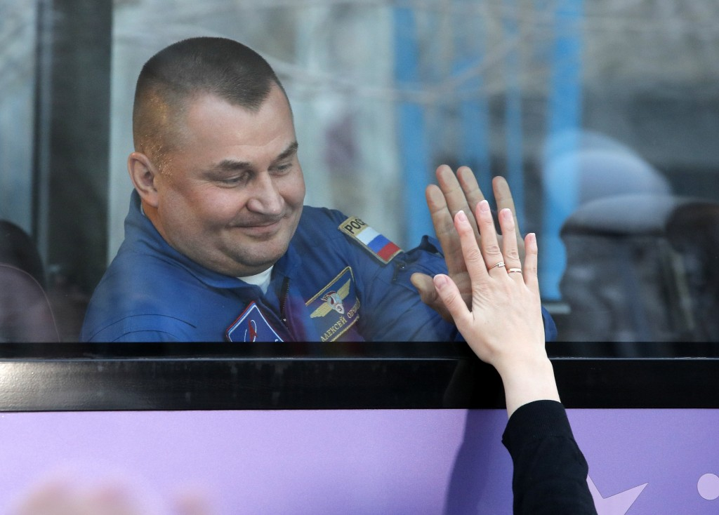 Russian cosmonaut Alexey Ovchinin, a members of the main crew to the International Space Station (ISS), interacts with his relative from a bus prior t