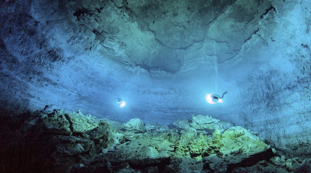 In this undated photo released by Mexico's National Institute of Anthropology and History, INAH, scuba divers explore the Hoyo Negro underwater cave i