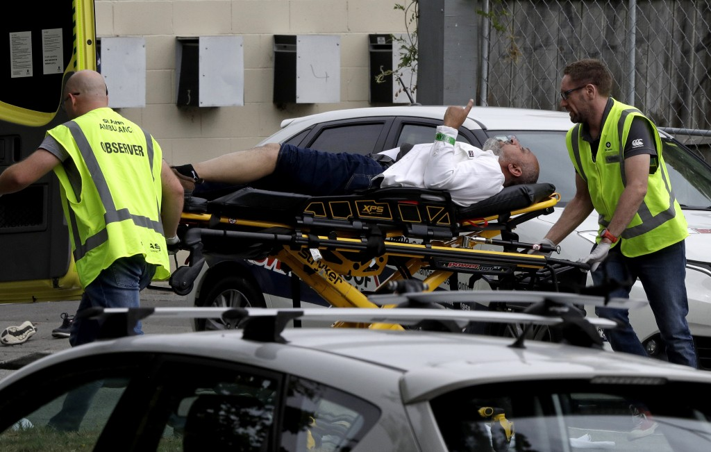 Ambulance staff take a man from outside a mosque in central Christchurch, New Zealand, Friday, March 15, 2019.  A witness says many people have been k