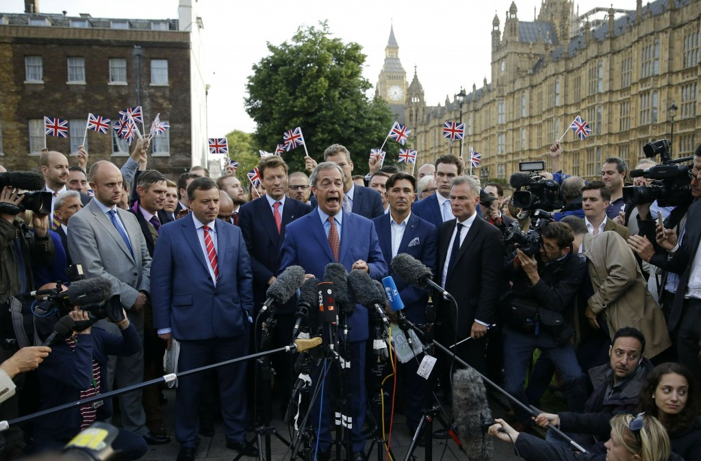 FILE - In this Friday, June 24, 2016 file photo Nigel Farage, the leader of the UK Independence Party speaks to the media on College Green with the Ho