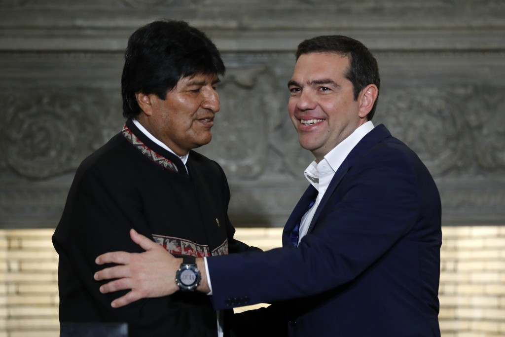 Greece's Prime Minister Alexis Tsipras, right, shakes hands with Bolivia's President Evo Morales after their press conference at Maximos Mansion in At