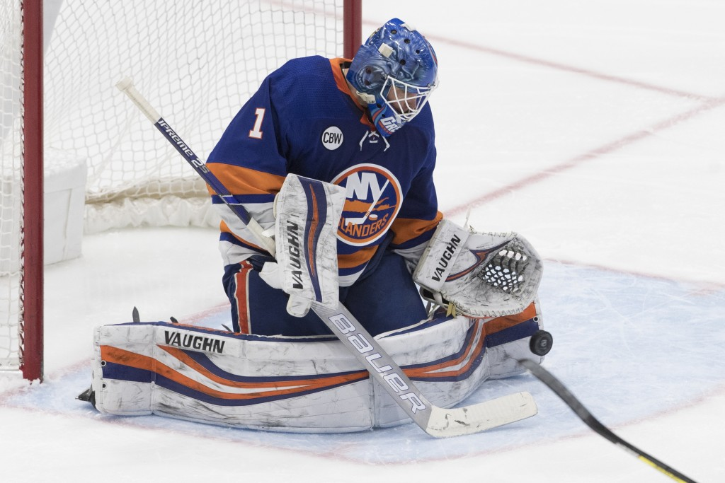 New York Islanders goaltender Thomas Greiss makes a save during the third period of the team's NHL hockey game against the Montreal Canadiens, Thursda