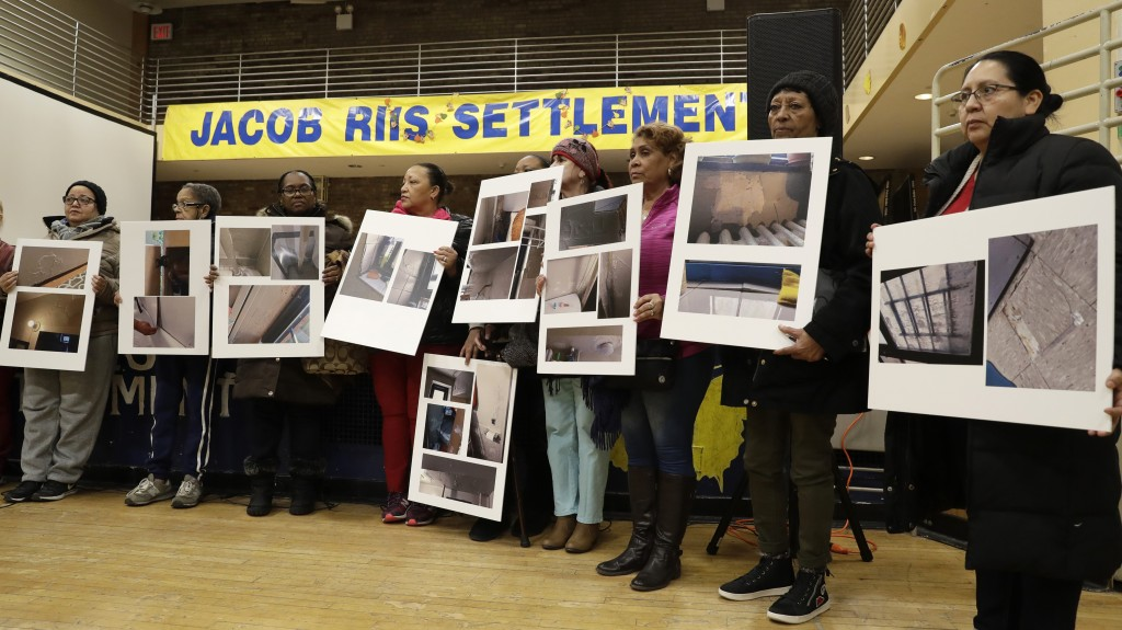In this March 7, 2019 photo, residents of the Jacob Riis Settlement at the Queensbridge Houses, the largest public housing project in New York City, h